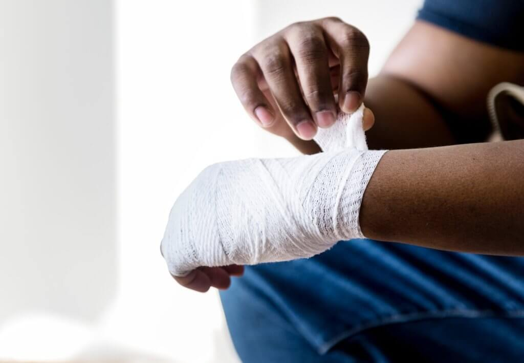 Person with Injured Hand