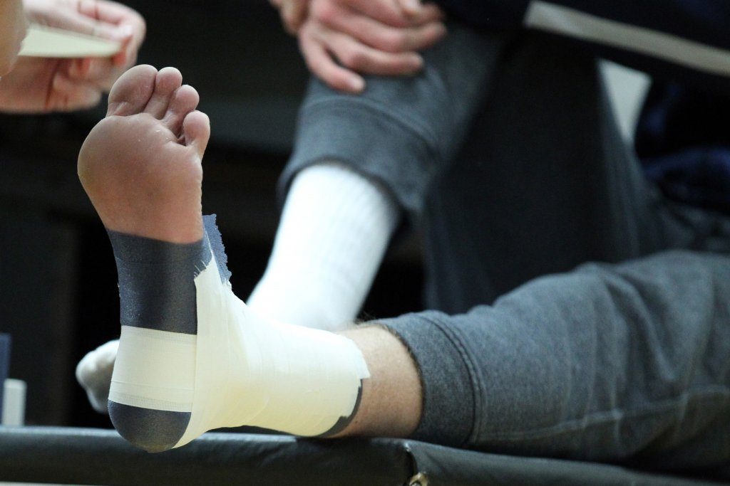 Athlete with Taped Ankle