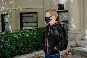 Schoolboy wearing medical mask